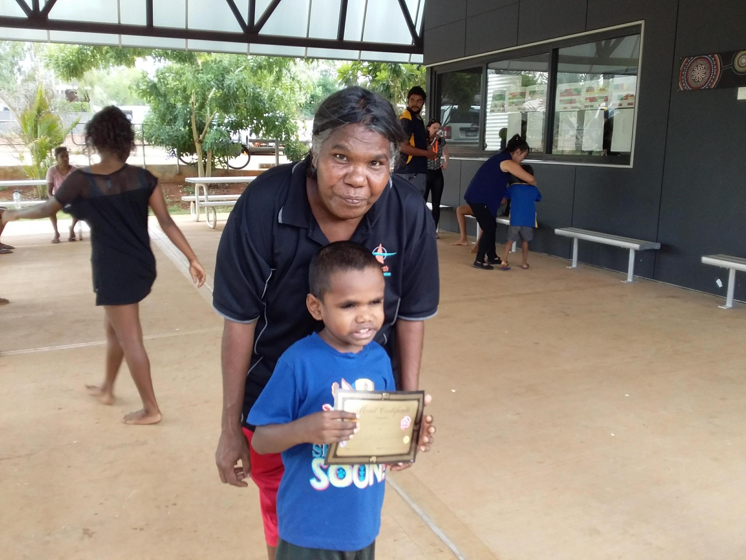 kid-receiving-school-certificate